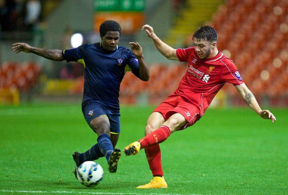 ANFIELD, ENGLAND - Thursday, October 16, 2014: Liverpool's Joe Maguire in action against Southampton's Omar Rowe during the Under 21 FA Premier League match at Anfield. (Pic by David Rawcliffe/Propaganda)