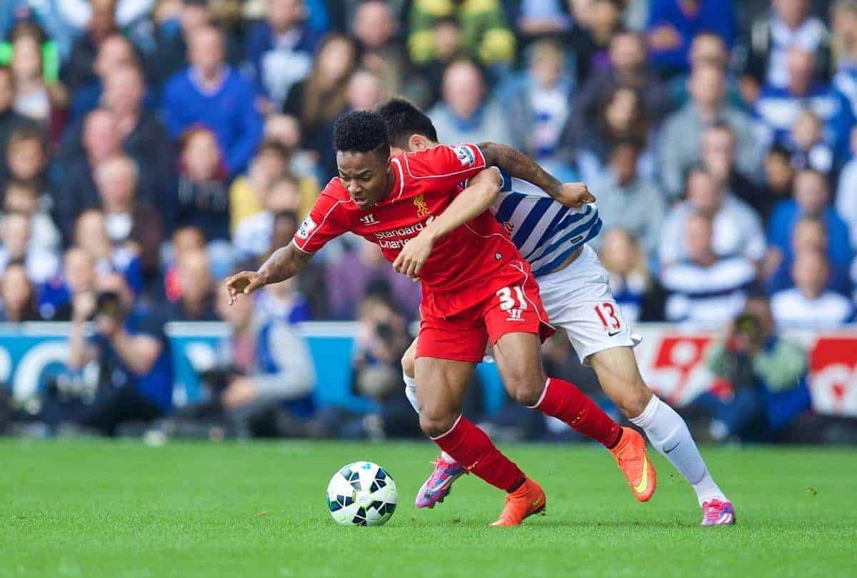 LONDON, ENGLAND - Sunday, October 19, 2014: Liverpool's Raheem Sterling in action against Queens Park Rangers' Yun Suk-Young during the Premier League match at Loftus Road. (Pic by David Rawcliffe/Propaganda)
