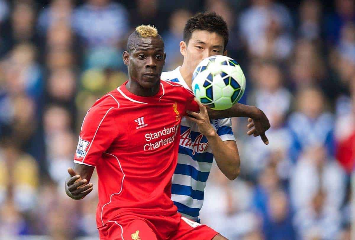LONDON, ENGLAND - Sunday, October 19, 2014: Liverpool's Mario Balotelli in action against Queens Park Rangers' Yun Suk-Young during the Premier League match at Loftus Road. (Pic by David Rawcliffe/Propaganda)