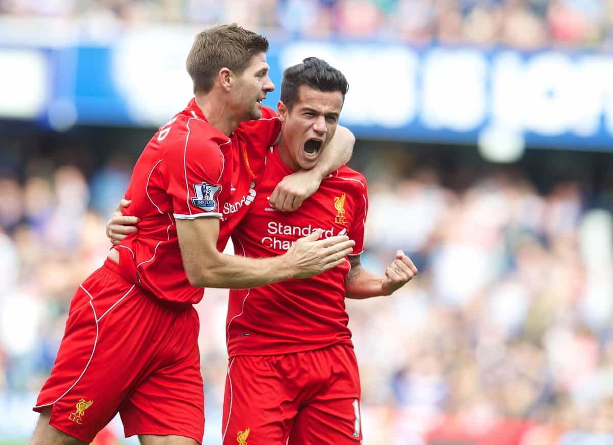LONDON, ENGLAND - Sunday, October 19, 2014: Liverpool's Philippe Coutinho Correia celebrates scoring the second goal against Queens Park Rangers with team-mate captain Steven Gerrard during the Premier League match at Loftus Road. (Pic by David Rawcliffe/Propaganda)