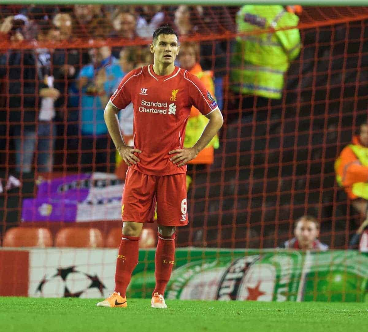 LIVERPOOL, ENGLAND - Wednesday, October 22, 2014: Liverpool's Dejan Lovren looks dejected as Real Madrid CF score the third goal during the UEFA Champions League Group B match at Anfield. (Pic by David Rawcliffe/Propaganda)