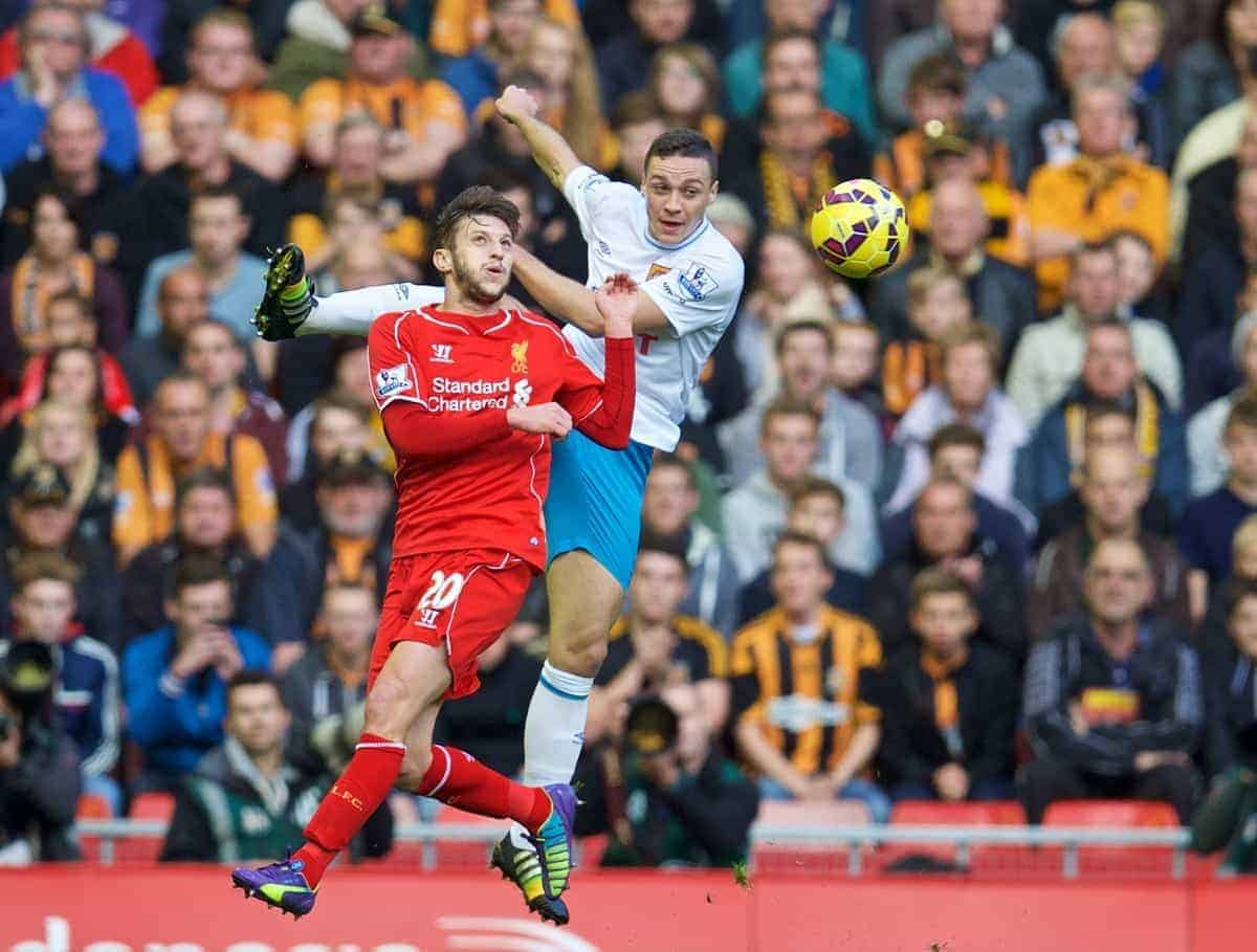 LIVERPOOL, ENGLAND - Saturday, October 25, 2014: Liverpool's Adam Lallana in action against Hull City's James Chester during the Premier League match at Anfield. (Pic by David Rawcliffe/Propaganda)