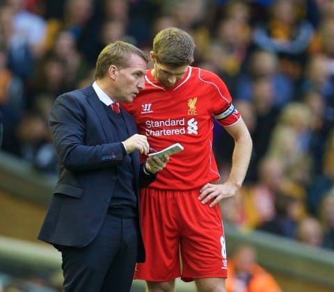 LIVERPOOL, ENGLAND - Saturday, October 25, 2014: Liverpool's manager Brendan Rodgers gives instructions to captain Steven Gerrard against Hull City during the Premier League match at Anfield. (Pic by David Rawcliffe/Propaganda)