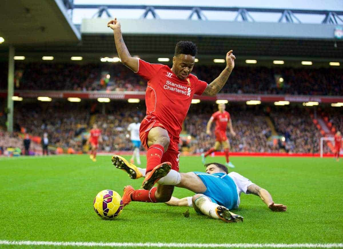 LIVERPOOL, ENGLAND - Saturday, October 25, 2014: Liverpool's Raheem Sterling in action against Hull City's Robbie Brady during the Premier League match at Anfield. (Pic by David Rawcliffe/Propaganda)