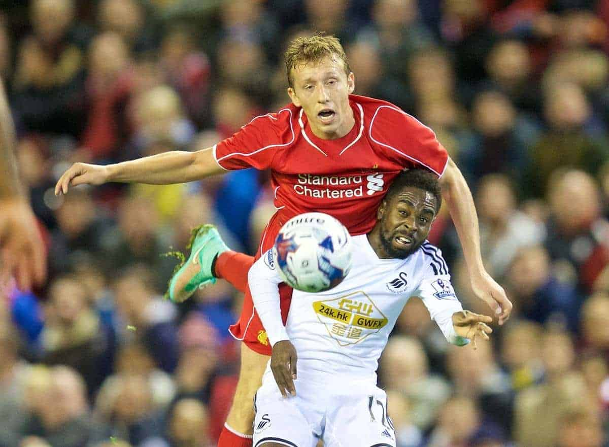 LIVERPOOL, ENGLAND - Tuesday, October 28, 2014: Liverpool's Lucas Leiva in action against Swansea City's Nathan Dyer during the Football League Cup 4th Round match at Anfield. (Pic by David Rawcliffe/Propaganda)