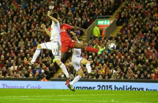 LIVERPOOL, ENGLAND - Tuesday, October 28, 2014: Liverpool's Mario Balotelli scores the first goal against Swansea City during the Football League Cup 4th Round match at Anfield. (Pic by David Rawcliffe/Propaganda)