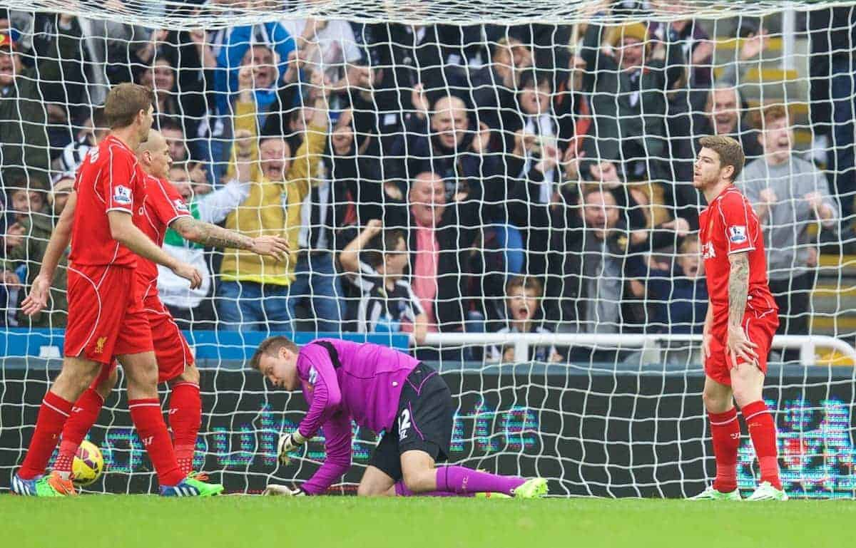 NEWCASTLE-UPON-TYNE, ENGLAND - Saturday, November 1, 2014: Liverpool's goalkeeper Simon Mignolet and Alberto Moreno look dejected as Newcastle United score the first goal during the Premier League match at St. James' Park. (Pic by David Rawcliffe/Propaganda)