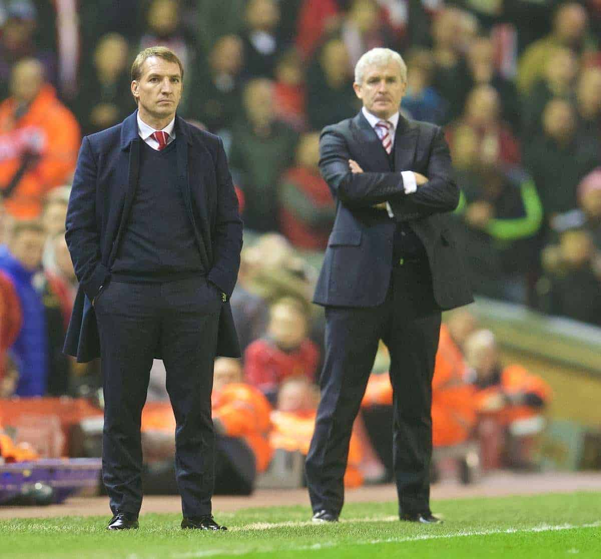 Liverpool's manager Brendan Rodgers and Stoke City's manager Mark Hughes during the Premier League match at Anfield. (Pic by David Rawcliffe/Propaganda)