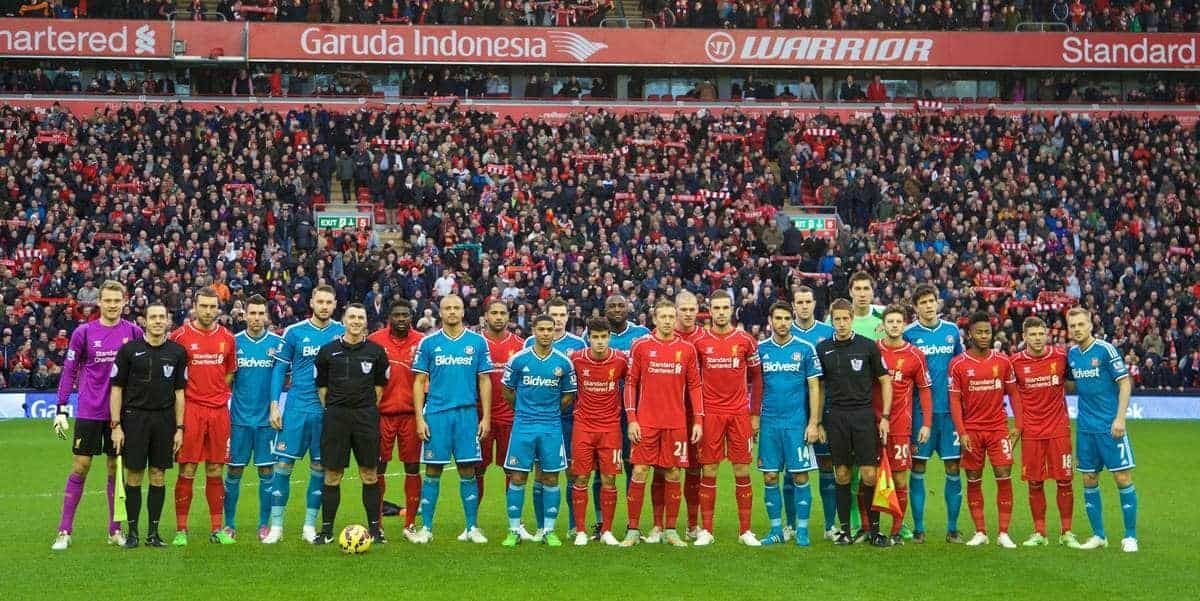 LIVERPOOL, ENGLAND - Saturday, December 6, 2014: Liverpool and Sunderland players stand together for Football Remembers during the Premier League match at Anfield. (Pic by David Rawcliffe/Propaganda)
