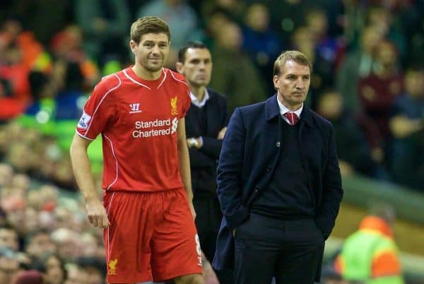 LIVERPOOL, ENGLAND - Saturday, December 6, 2014: Liverpool's manager Brendan Rodgers prepares to bring on substitute captain Steven Gerrard against Sunderland during the Premier League match at Anfield. (Pic by David Rawcliffe/Propaganda)