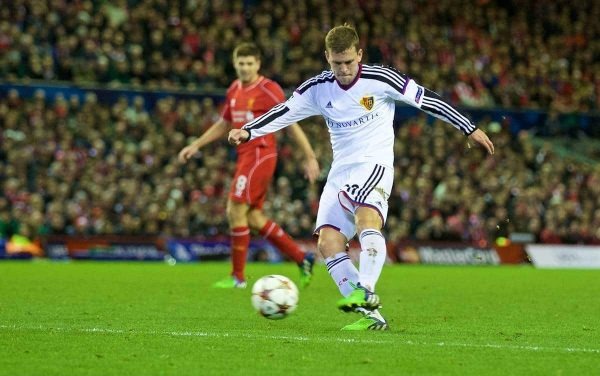 LIVERPOOL, ENGLAND - Tuesday, December 9, 2014: FC Basel's Fabian Frei scores the first goal against Liverpool during the final UEFA Champions League Group B match at Anfield. (Pic by David Rawcliffe/Propaganda)