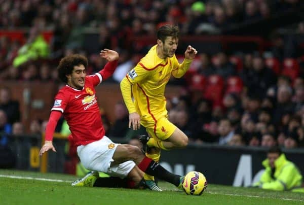 MANCHESTER, ENGLAND - Sunday, December 14, 2014: Liverpool's Adam Lallana is fouled by Manchester United's Guillermo Varela during the Premier League match at Old Trafford. (Pic by David Rawcliffe/Propaganda)