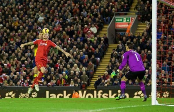 LIVERPOOL, ENGLAND - Sunday, December 21, 2014: Arsenal's Mathieu Debuchy beats Liverpool's Martin Skrtel to a header to score the first equalising goal during the Premier League match at Anfield. (Pic by David Rawcliffe/Propaganda)