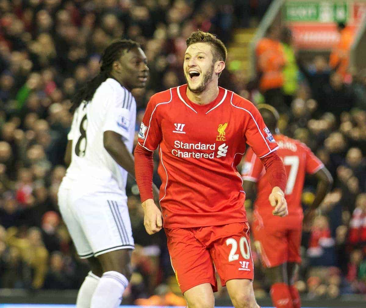 LIVERPOOL, ENGLAND - Monday, December 29, 2014: Liverpool's Adam Lallana celebrates his side's fourth goal against Swansea City during the Premier League match at Anfield. (Pic by David Rawcliffe/Propaganda)
