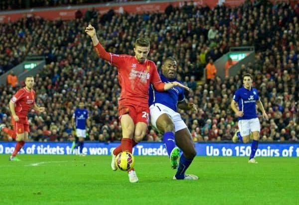 LIVERPOOL, ENGLAND - Thursday, New Year's Day, January 1, 2015: Liverpool's Fabio Borini is brought down by Leicester City's captain Wes Morgan but no penalty was awarded during the Premier League match at Anfield. (Pic by David Rawcliffe/Propaganda)