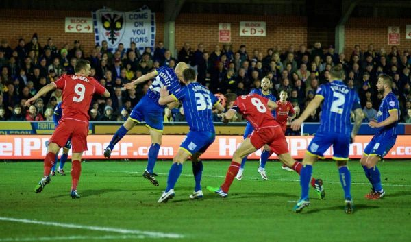 KINGSTON-UPON-THAMES, ENGLAND - Monday, January 5, 2015: Liverpool's captain Steven Gerrard scores the first goal against AFC Wimbledon during the FA Cup 3rd Round match at the Kingsmeadow Stadium. (Pic by David Rawcliffe/Propaganda)