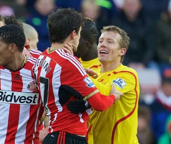 SUNDERLAND, ENGLAND - Saturday, January 10, 2015: Liverpool's Lucas Leiva clashes with Sunderland's Santiago Vergini during the Premier League match at the Stadium of Light. (Pic by David Rawcliffe/Propaganda)