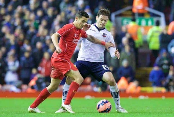 LIVERPOOL, ENGLAND - Saturday, January 24, 2015: Liverpool's Philippe Coutinho Correia in action against Bolton Wanderers' Dorian Dervite during the FA Cup 4th Round match at Anfield. (Pic by Lindsey Parnaby/Propaganda)