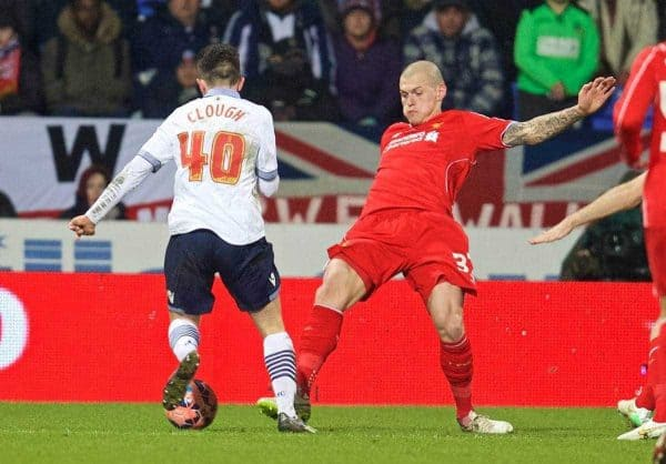 BOLTON, ENGLAND - Wednesday, February 4, 2015: Liverpool's Martin Skrtel brings down Bolton Wanderers' Zach Clough for a penalty during the FA Cup 4th Round Replay match at the Reebok Stadium. (Pic by David Rawcliffe/Propaganda)