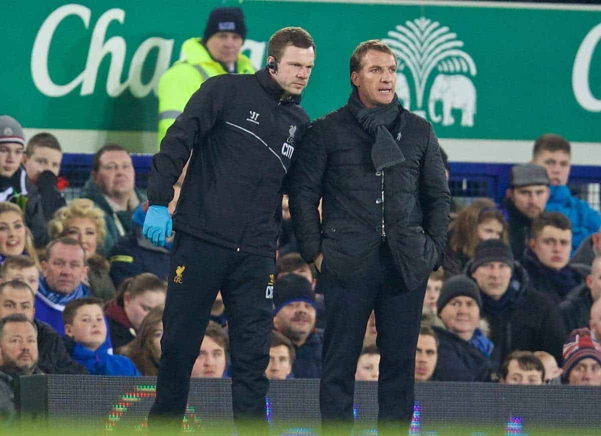 LIVERPOOL, ENGLAND - Friday, February 6, 2015: Liverpool's physiotherapist Chris Morgan gives manager Brendan Rodgers an update after Daniel Sturridge leaves the substitute bench down the tunnel against Everton during the Premier League match at Goodison Park, the 224th Merseyside Derby. (Pic by David Rawcliffe/Propaganda)
