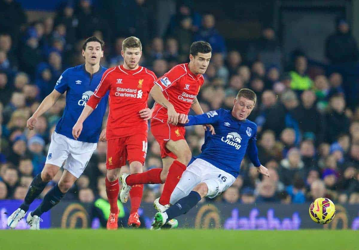 LIVERPOOL, ENGLAND - Friday, February 6, 2015: Liverpool's Philippe Coutinho Correia is fouled by Everton's James McCarthy, who was shown a yellow card for the challenge, during the Premier League match at Goodison Park, the 224th Merseyside Derby. (Pic by David Rawcliffe/Propaganda)