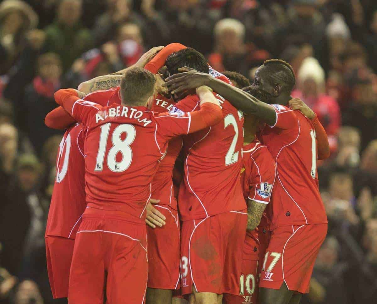LIVERPOOL, ENGLAND - Tuesday, February 10, 2015: Liverpool's Mario Balotelli [hidden] celebrates scoring the third goal against Tottenham Hotspur with team-mates during the Premier League match at Anfield. (Pic by David Rawcliffe/Propaganda)