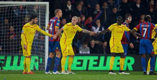 LONDON, ENGLAND - Saturday, February 14, 2015: Liverpool's Emre Can, Martin Skrtel and Mamadou Sakho hold hands against Crystal Palace during the FA Cup 5th Round match at Selhurst Park. (Pic by David Rawcliffe/Propaganda)