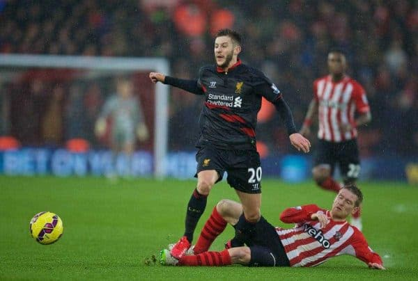 SOUTHAMPTON, ENGLAND - Sunday, February 22, 2015: Liverpool's Adam Lallana in action against Southampton's Matt Targett during the FA Premier League match at St Mary's Stadium. (Pic by David Rawcliffe/Propaganda)