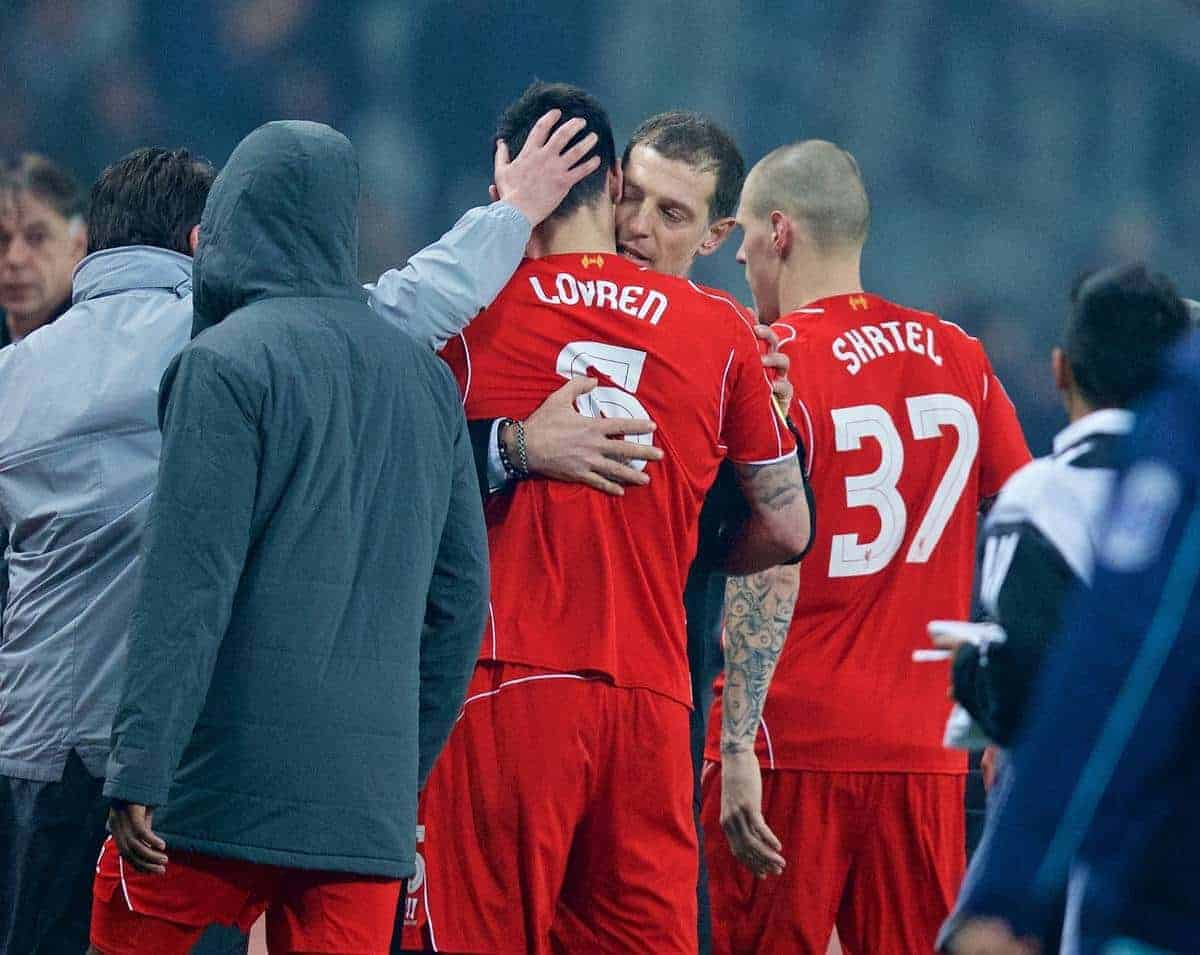 ISTANBUL, TURKEY - Thursday, February 26, 2015: Besiktas JK's head coach Slaven Bilic consoles Liverpool's Dejan Lovren, who missed the vital fifth penalty shooting over the bar in the shoot-out after a 1-1 aggregate draw, during the UEFA Europa League Round of 32 2nd Leg match at the Ataturk Olympic Stadium. (Pic by David Rawcliffe/Propaganda)