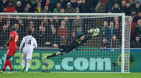 SWANSEA, ENGLAND - Monday, March 16, 2015: Liverpool's goalkeeper Simon Mignolet makes a save against Swansea City during the Premier League match at the Liberty Stadium. (Pic by David Rawcliffe/Propaganda)