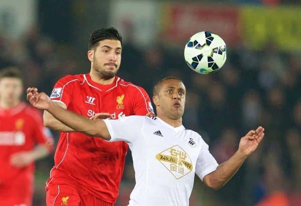 SWANSEA, ENGLAND - Monday, March 16, 2015: Liverpool's Emre Can in action against Swansea City's Wayne Routledge during the Premier League match at the Liberty Stadium. (Pic by David Rawcliffe/Propaganda)