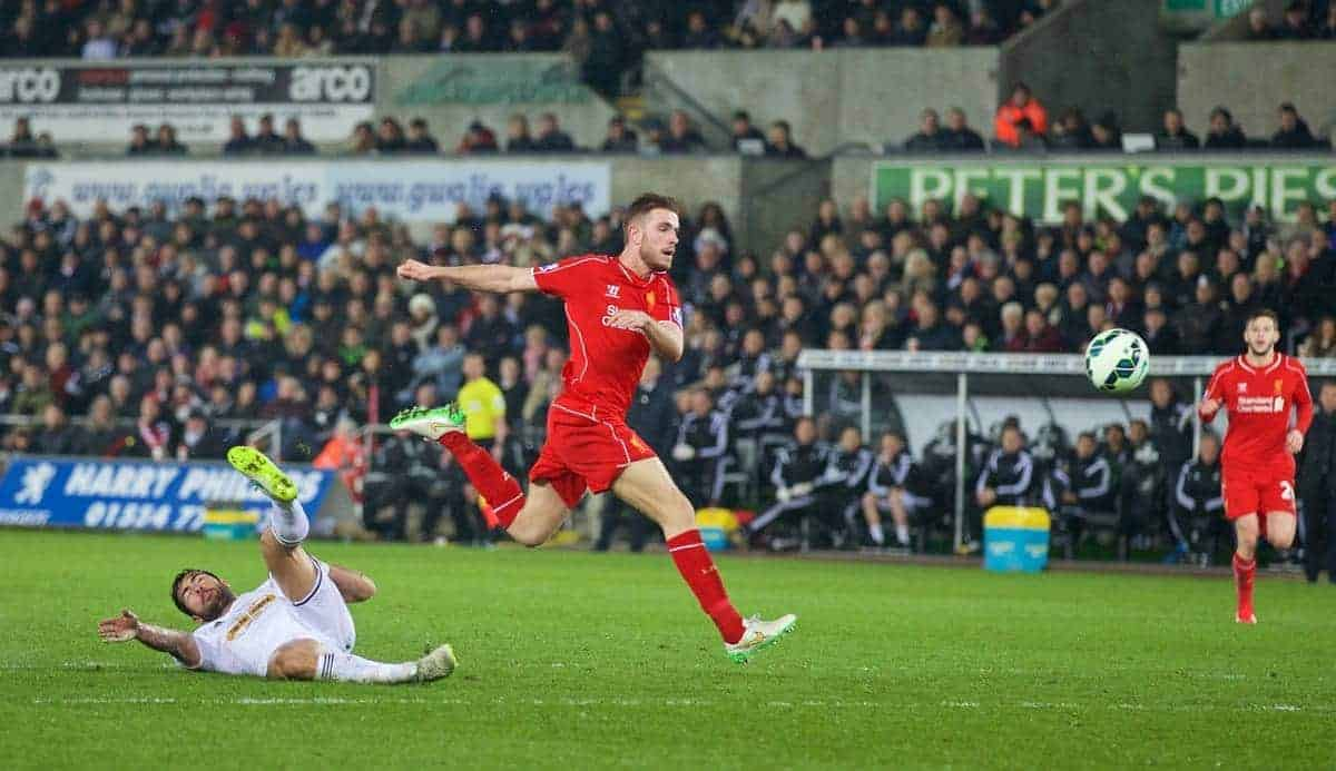 SWANSEA, ENGLAND - Monday, March 16, 2015: Liverpool's captain Jordan Henderson scores the first goal against Swansea City during the Premier League match at the Liberty Stadium. (Pic by David Rawcliffe/Propaganda)