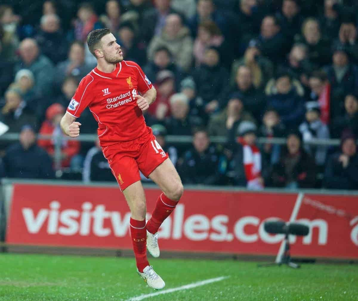 SWANSEA, ENGLAND - Monday, March 16, 2015: Liverpool's captain Jordan Henderson celebrates scoring the first goal against Swansea City during the Premier League match at the Liberty Stadium. (Pic by David Rawcliffe/Propaganda)