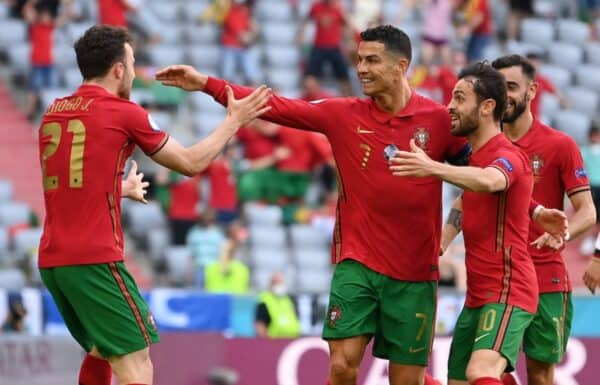 MUNICH, GERMANY - JUNE 19: Cristiano Ronaldo of Portugal celebrates with Diogo Jota and Bernardo Silva after scoring their side's first goal during the UEFA Euro 2020 Championship Group F match between Portugal and Germany at Football Arena Munich on June 19, 2021 in Munich, Germany. (Photo by Sebastian Widmann - UEFA/UEFA via Getty Images)