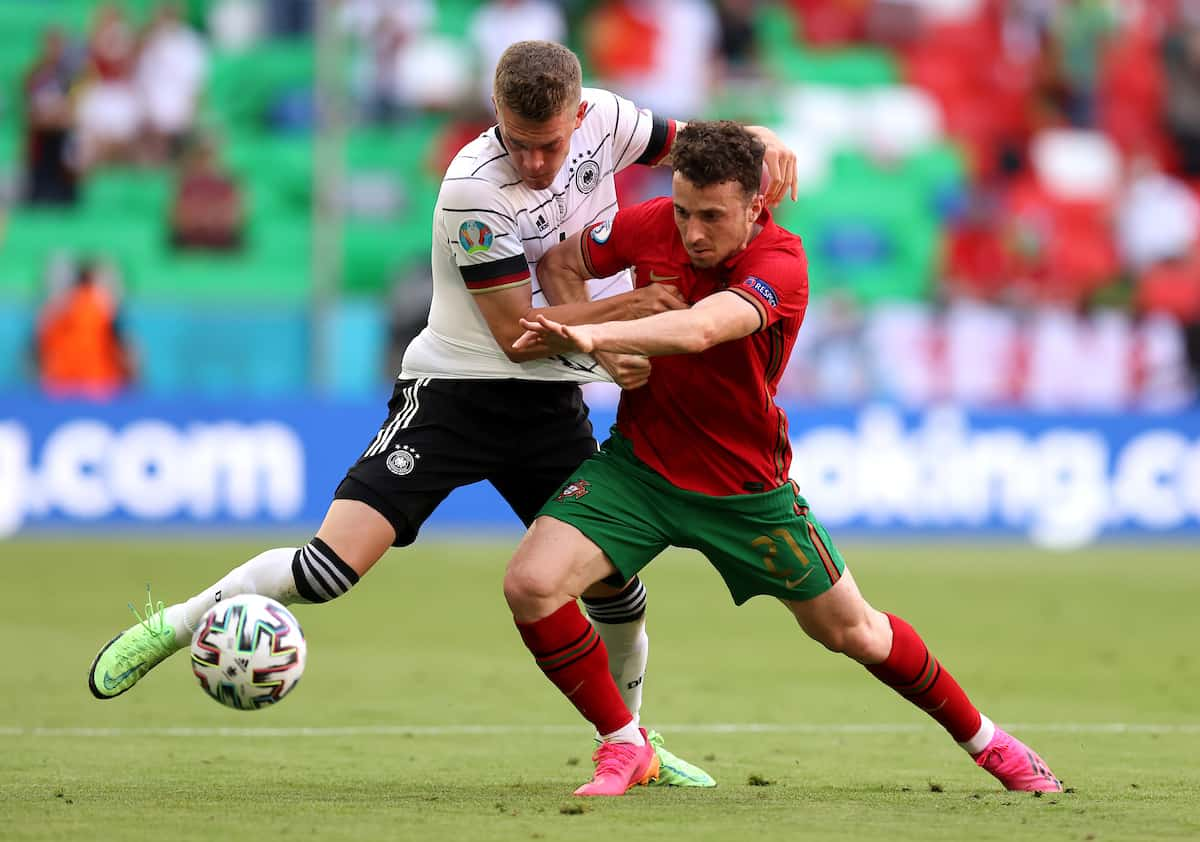 MUNICH, GERMANY - JUNE 19: Diogo Jota of Portugal holds off Matthias Ginter of Germany during the UEFA Euro 2020 Championship Group F match between Portugal and Germany at Football Arena Munich on June 19, 2021 in Munich, Germany. (Photo by Alex Grimm - UEFA/UEFA via Getty Images)