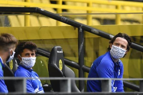Schalke substitute players sit on the bench during the German Bundesliga soccer match between Borussia Dortmund and Schalke 04 in Dortmund (Martin Meissner)