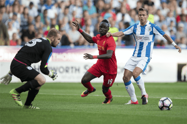 HUDDERSFIELD, ENGLAND - Wednesday, July 19, 2016: Liverpool's Sadio Mane in action against Huddersfield Town's Chris Lowe during the Shankly Trophy pre-season friendly match at the John Smith's Stadium. (Pic by Paul Greenwood/Propaganda)