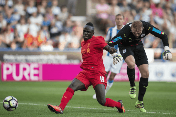 HUDDERSFIELD, ENGLAND - Wednesday, July 19, 2016: Liverpool's Sadio Mane scores his sides first goal but it is disallowed for a foul against Huddersfield Town's Joel Coleman during the Shankly Trophy pre-season friendly match at the John Smith's Stadium. (Pic by Paul Greenwood/Propaganda)