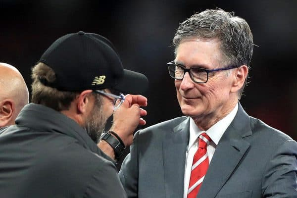 Jurgen Klopp (left) shakes hands with club owner John W. Henry (Mike Egerton / PA Images)