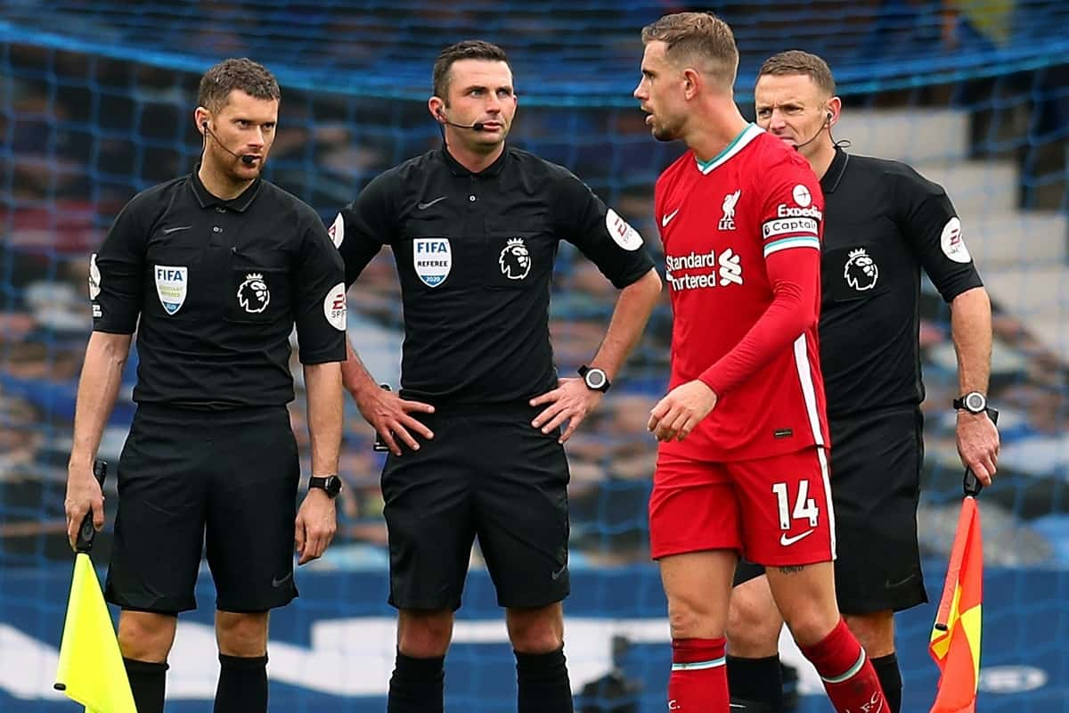 Liverpool's Jordan Henderson speaks to referee Michael Oliver after the Premier League match at Goodison Park, Liverpool.