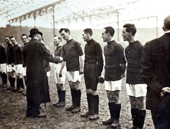 (Please credit within piece: The Wadsworth family) Walter Wadsworth greets King George, Liverpool vs. Manchester City, March 1920