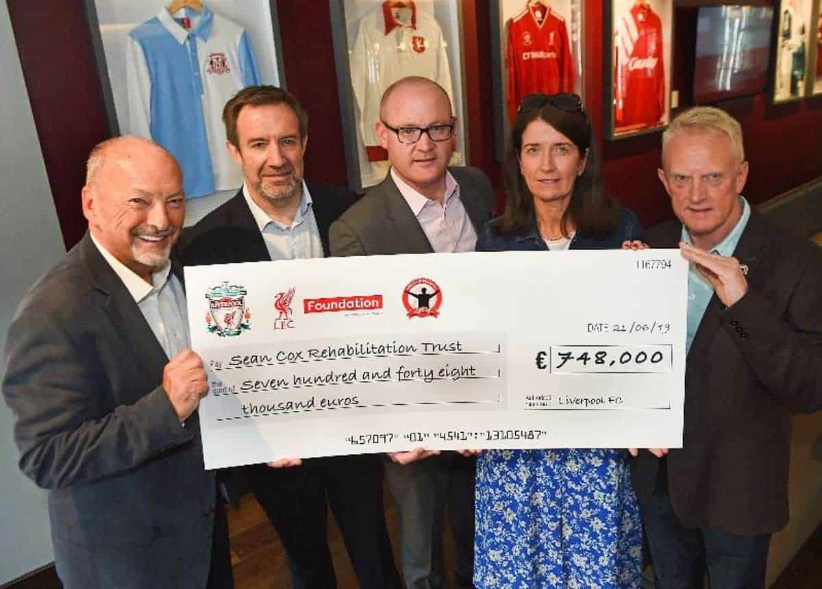 From left to right: Peter Moore (Chief Executive Officer of Liverpool Football Club), Matt Parish (Director of the Liverpool FC Foundation), Stephen Felle (Chairman of the Sean Cox Rehabilitation Trust) and Joe Blott (Chair of the Spirit of Shankly) (Credit: Liverpool FC)