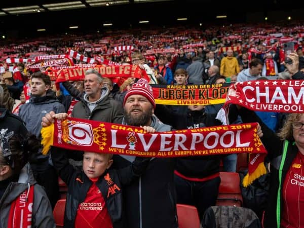 LIVERPOOL, ENGLAND - Sunday, August 8, 2021: Liverpool supporters on the Spion Kop hold up scarves and sing