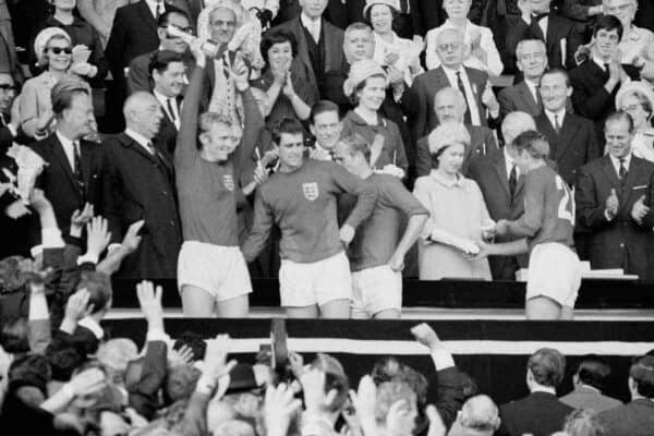 Roger Hunt receives his World Cup winners' medal from the Queen as England captain Bobby Moore holds the trophy aloft (PA).