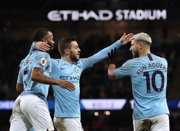 Manchester City's Sergio Aguero (right) celebrates scoring his side's third goal of the game with Raheem Sterling (left) and Mota Bernardo Silva during the Premier League match at the Etihad Stadium, Manchester.