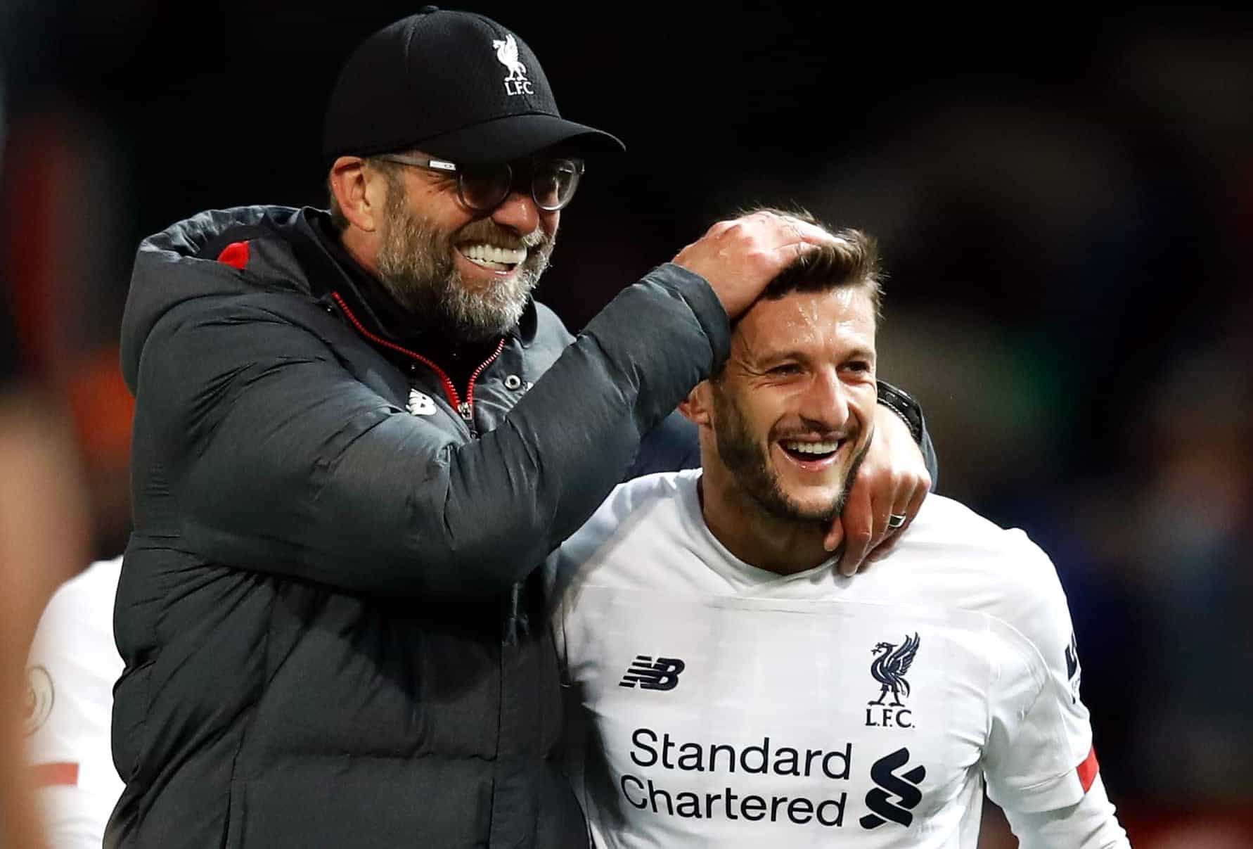 Liverpool manager Jurgen Klopp (left) celebrates with Adam Lallana after the Premier League match at Old Trafford, Manchester. (PA Media)