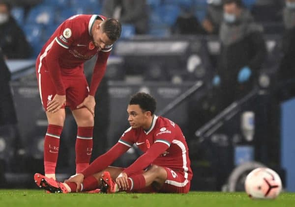 Liverpool's Trent Alexander-Arnold sits on the pitch before being substituted with an injury during the Premier League match at the Etihad Stadium, Manchester.