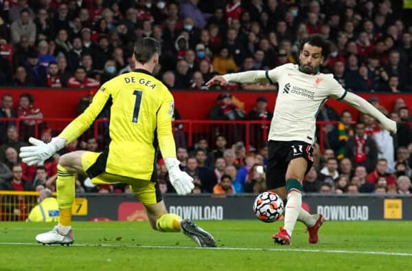 Liverpool's Mohamed Salah (right) scores his side's fifth goal and completes his hat trick during the Premier League match at Old Trafford, Manchester.  Picture date: Sunday October 24, 2021.