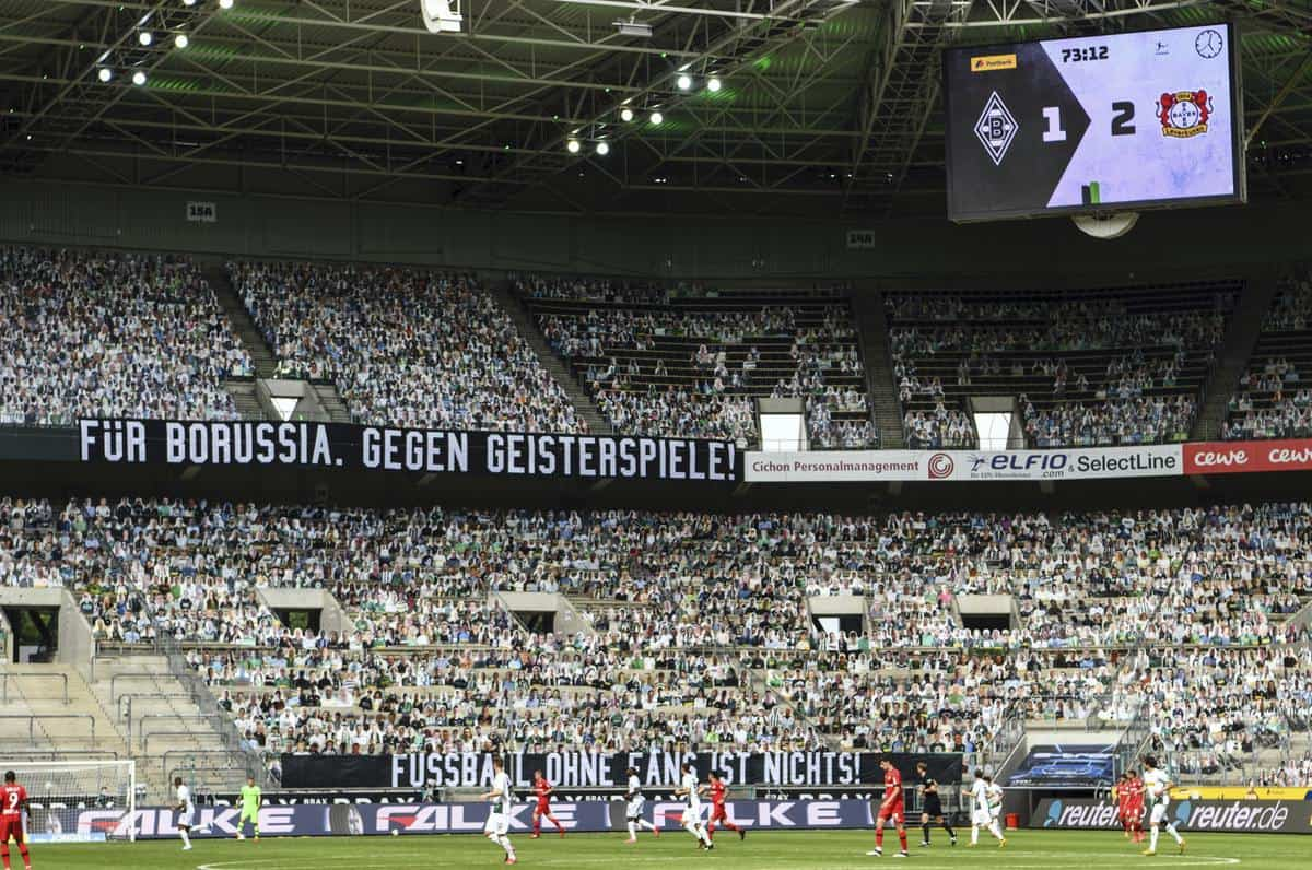Thousands of cardboard cutouts of fans were used in an otherwise empty stadium at Borussia-Park (Ina Fassbender/AP)