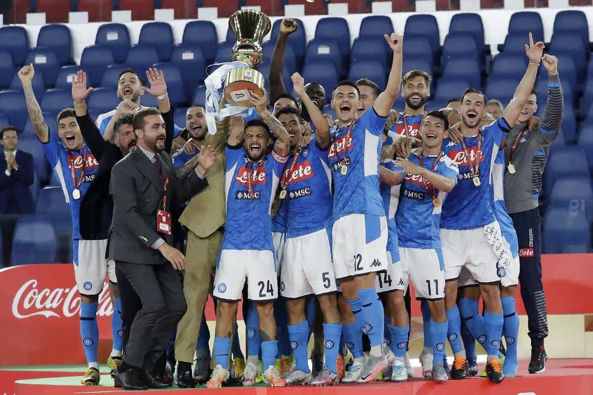 Napoli's Lorenzo Insigne holds up the trophy (Andrew Medichini/AP)
